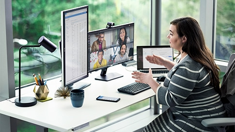A woman having a video conference while working from home