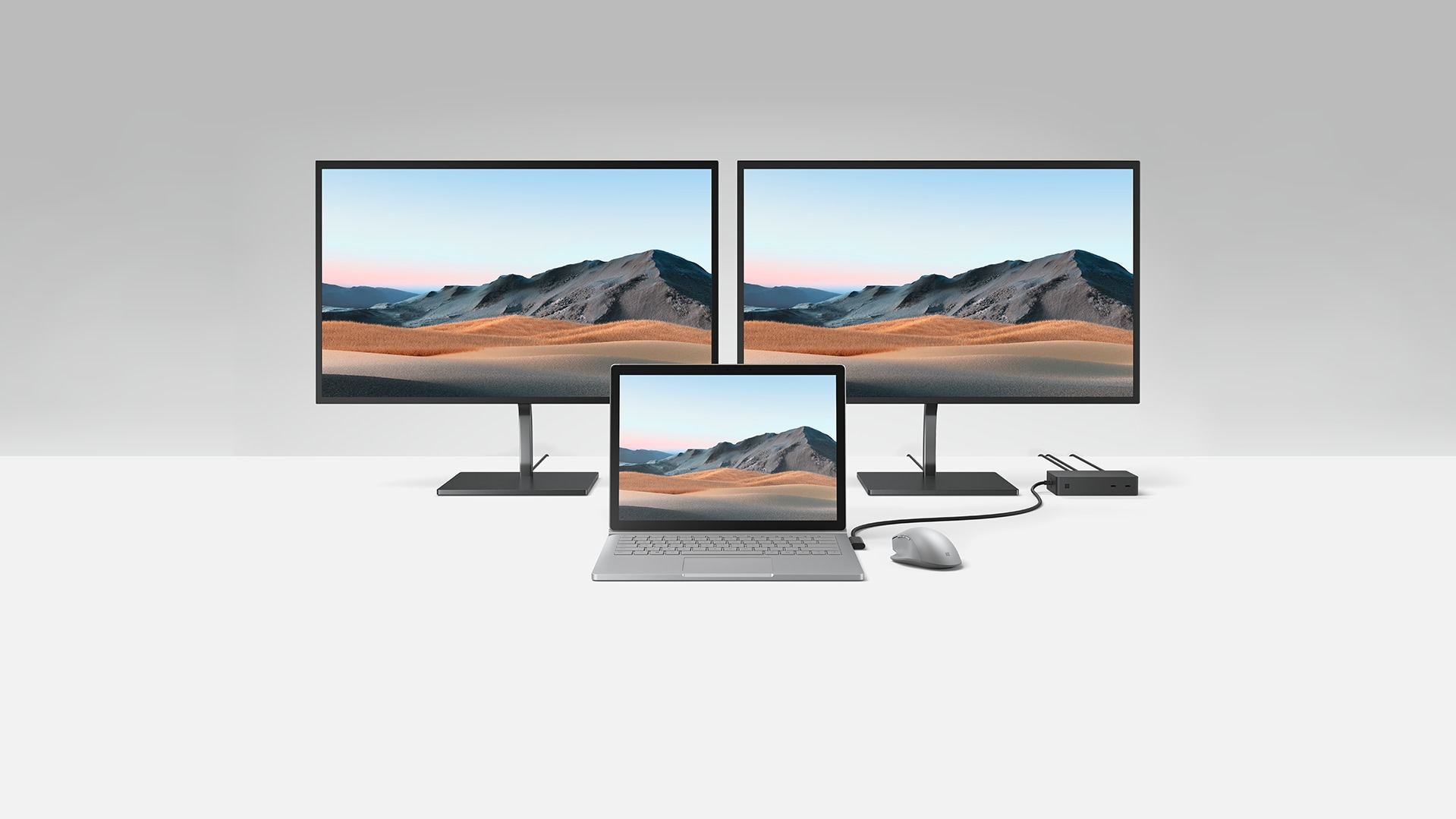 Multiple monitors and laptop connected to a Surface Dock