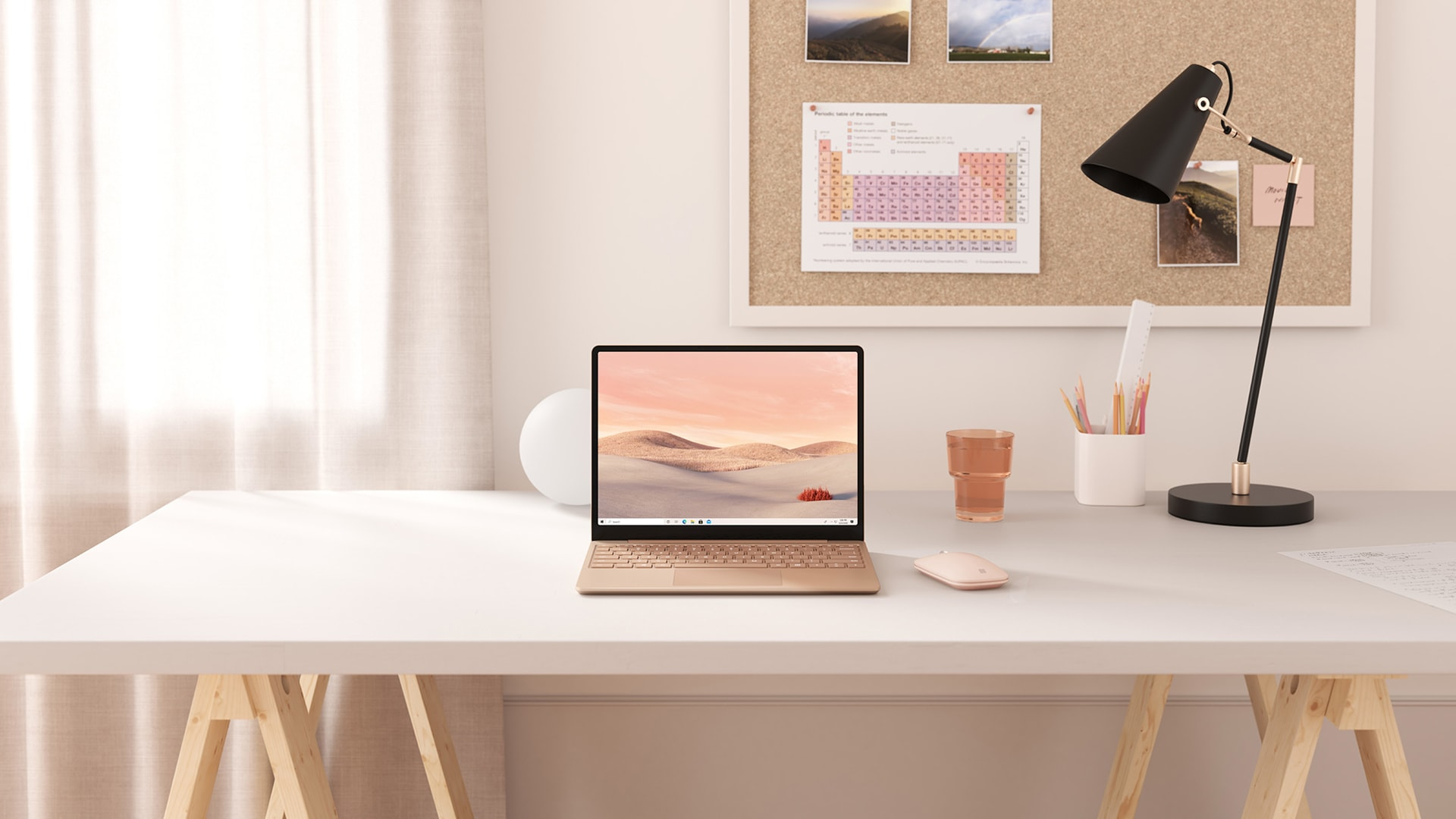Sandstone Surface Laptop Go on a desk