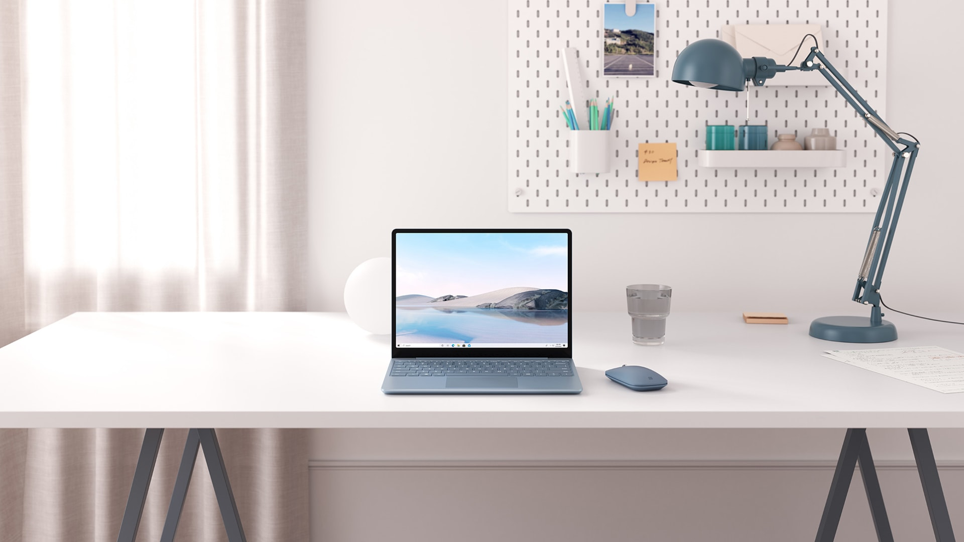 Ice Blue Surface Laptop Go on a desk