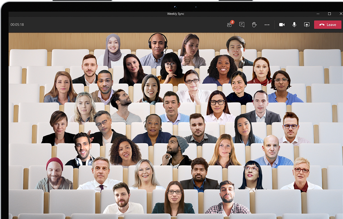 Photos of various people's head and shoulders edited to appear as if they're all sitting next to each other in auditorium seats.