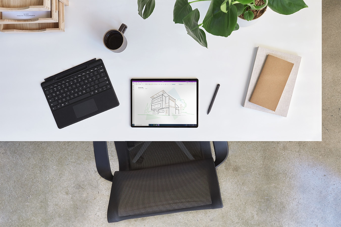 Surface Pro X on a desk with the Surface Pro X Signature Keyboard and Surface Slim Pen
