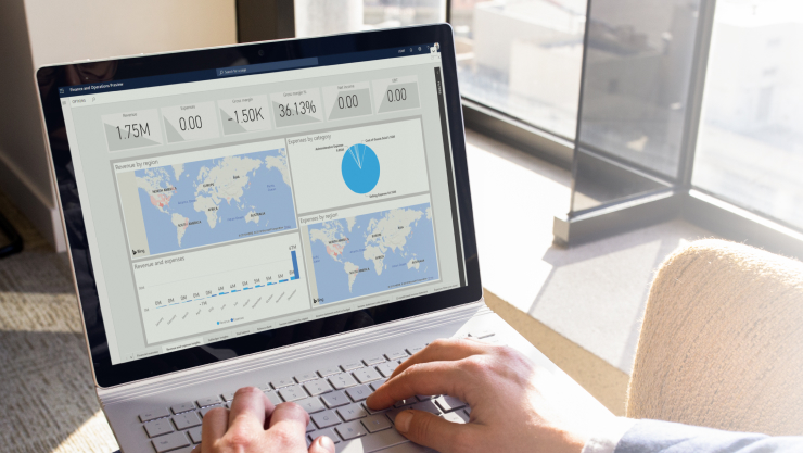 Illustration of charts and reports on a laptop screen.