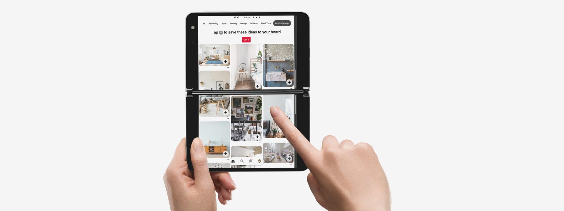 A pair of hands holding Surface Duo with Pinterest on the screen