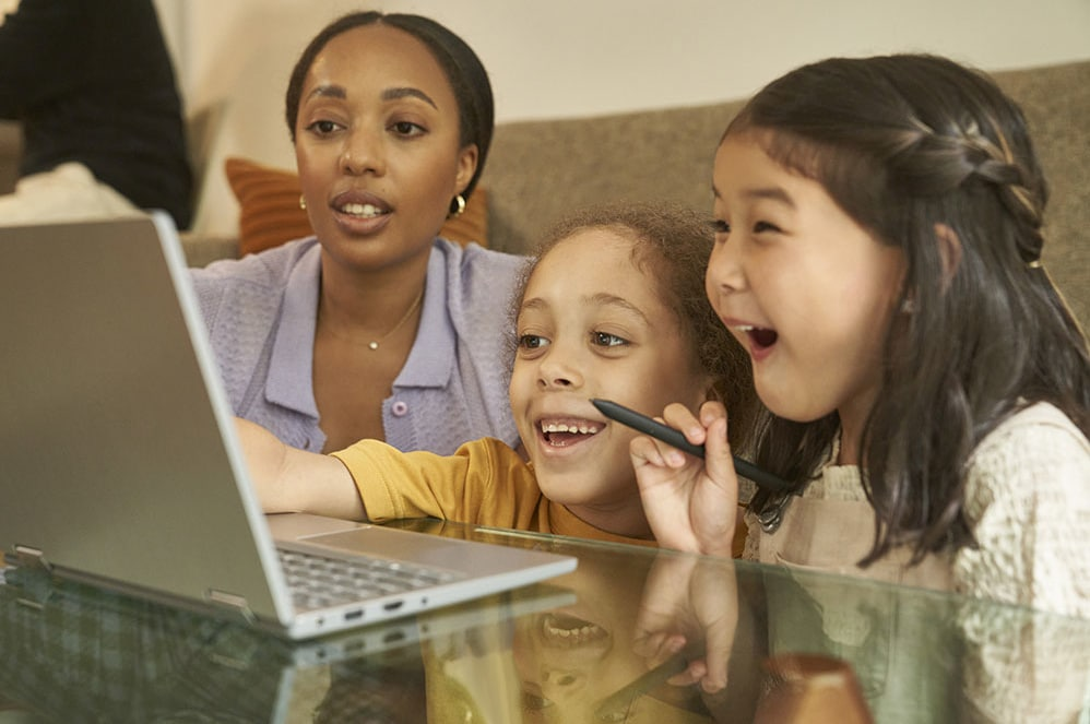 A tablet and smartphone displaying Microsoft Family Safety, next to a bowl of crisps and an Xbox controller.