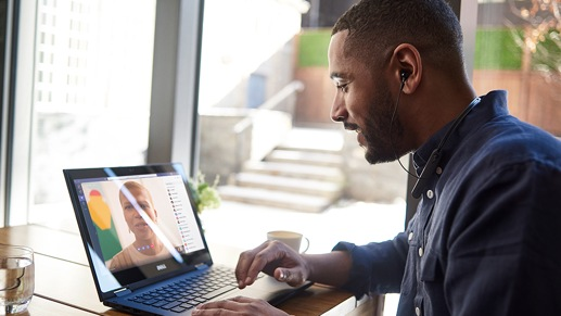 A person is using their laptop device to video call with another adult.