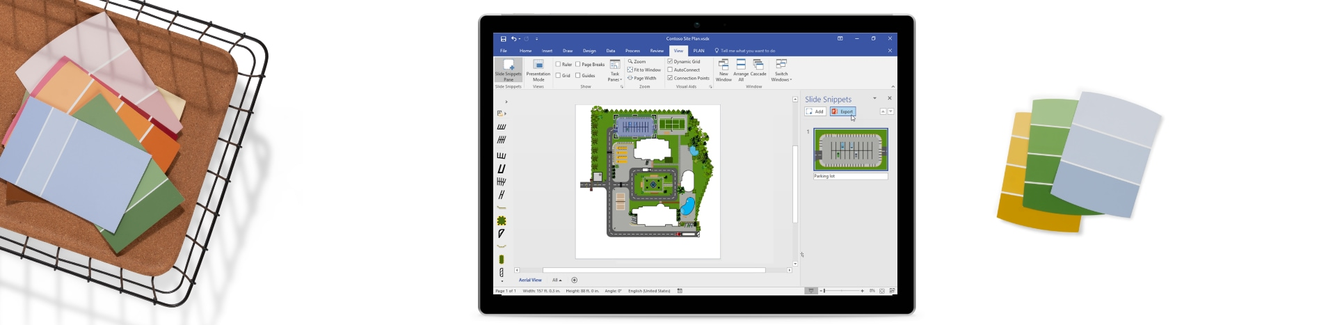 Multiple paint swatches in a basket and a tablet device showing a floorplan in Powerpoint.