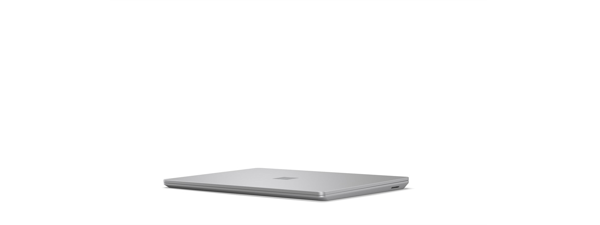 A Surface Laptop Go is shown in the closed position.