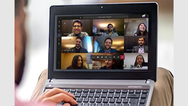 Person video chatting on a Teams call on a Surface Laptop device