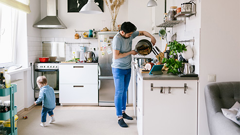 Man cooks in his home kitchen