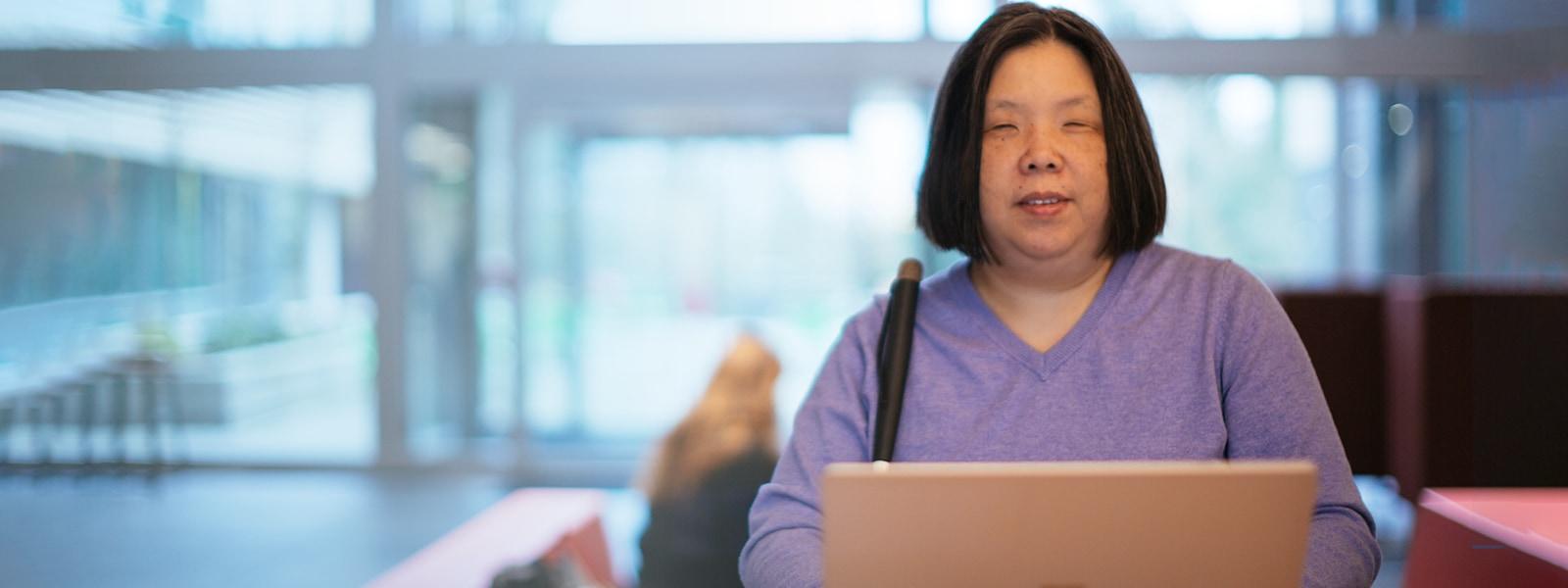 A blind woman using screen reader technology