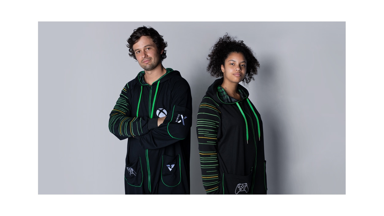 Two people standing wearing Xbox Series X Hooded Union Suits