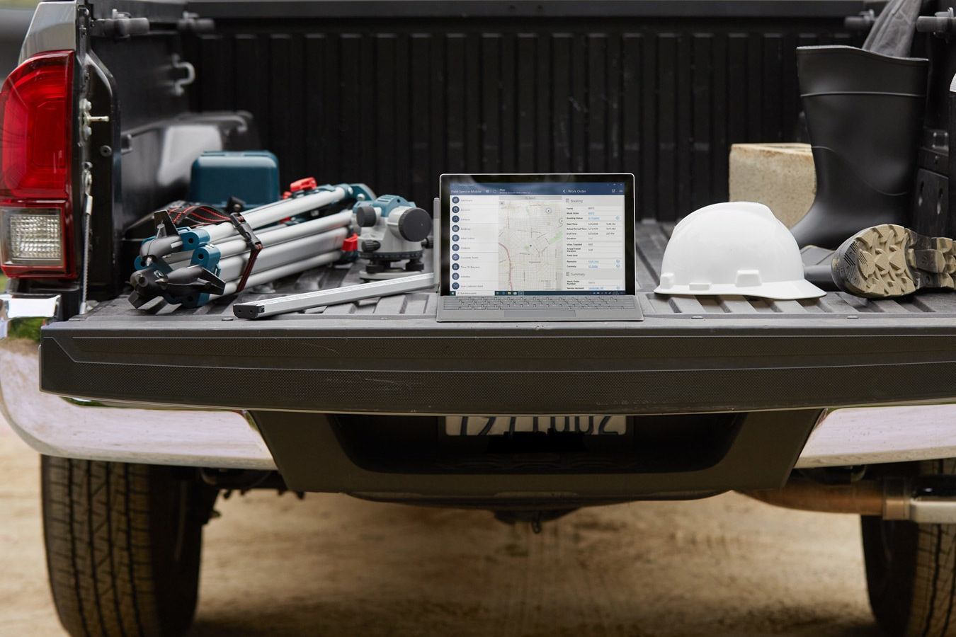 Surface Pro 7+‎ is shown in use while on the tailgate of a work truck at an offsite