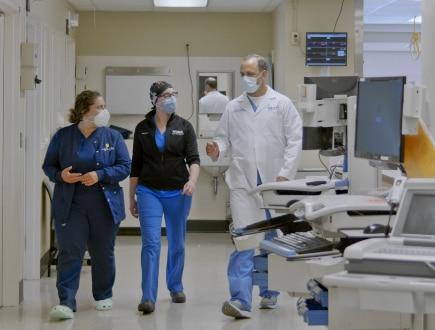Three medical professionals having a conversation.