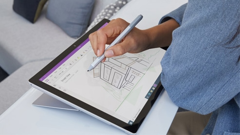 A person uses Surface Pen to take notes in the Microsoft Whiteboard application on a Surface Pro 7+ device