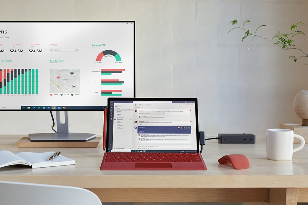 Surface Pro 7+ for Business on desktop with a monitor, mouse, notebook, and coffee mug.