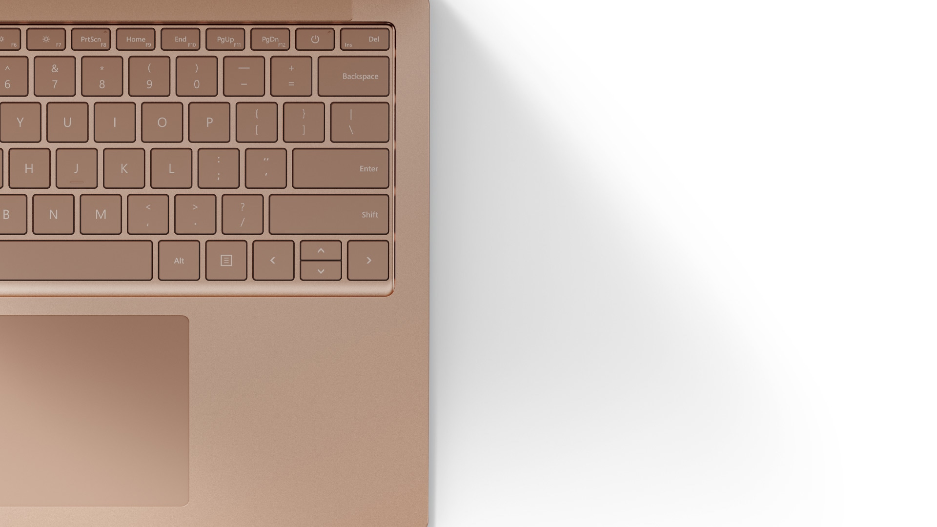 A close-up of Surface Laptop 4 smooth Sandstone metal finish