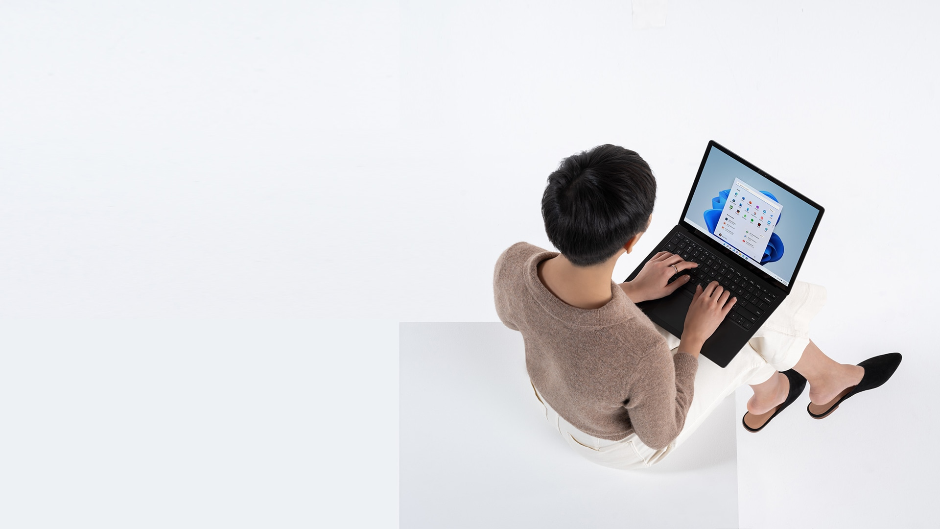 Person typing on Matte Black Surface Laptop 4