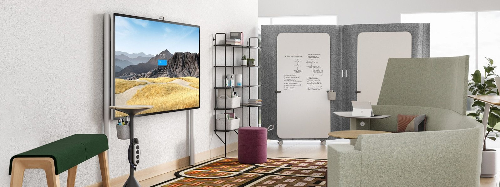 A Surface HUB 2S 85'' on a Floor Supported Wall Mount in an office setting.