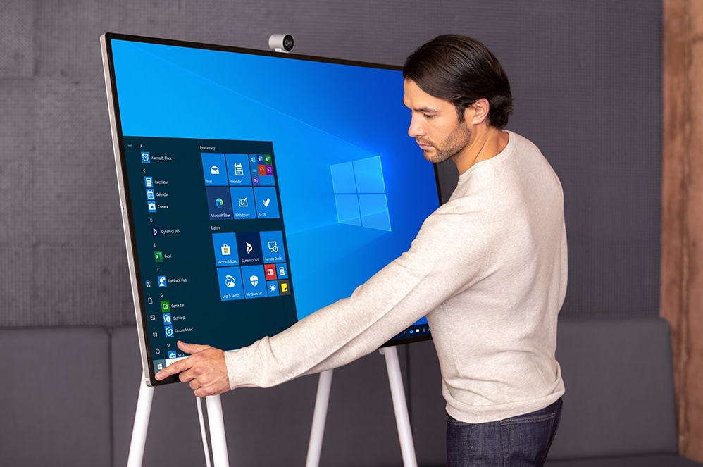 A person uses the touch screen feature on the Surface HUB 2S.