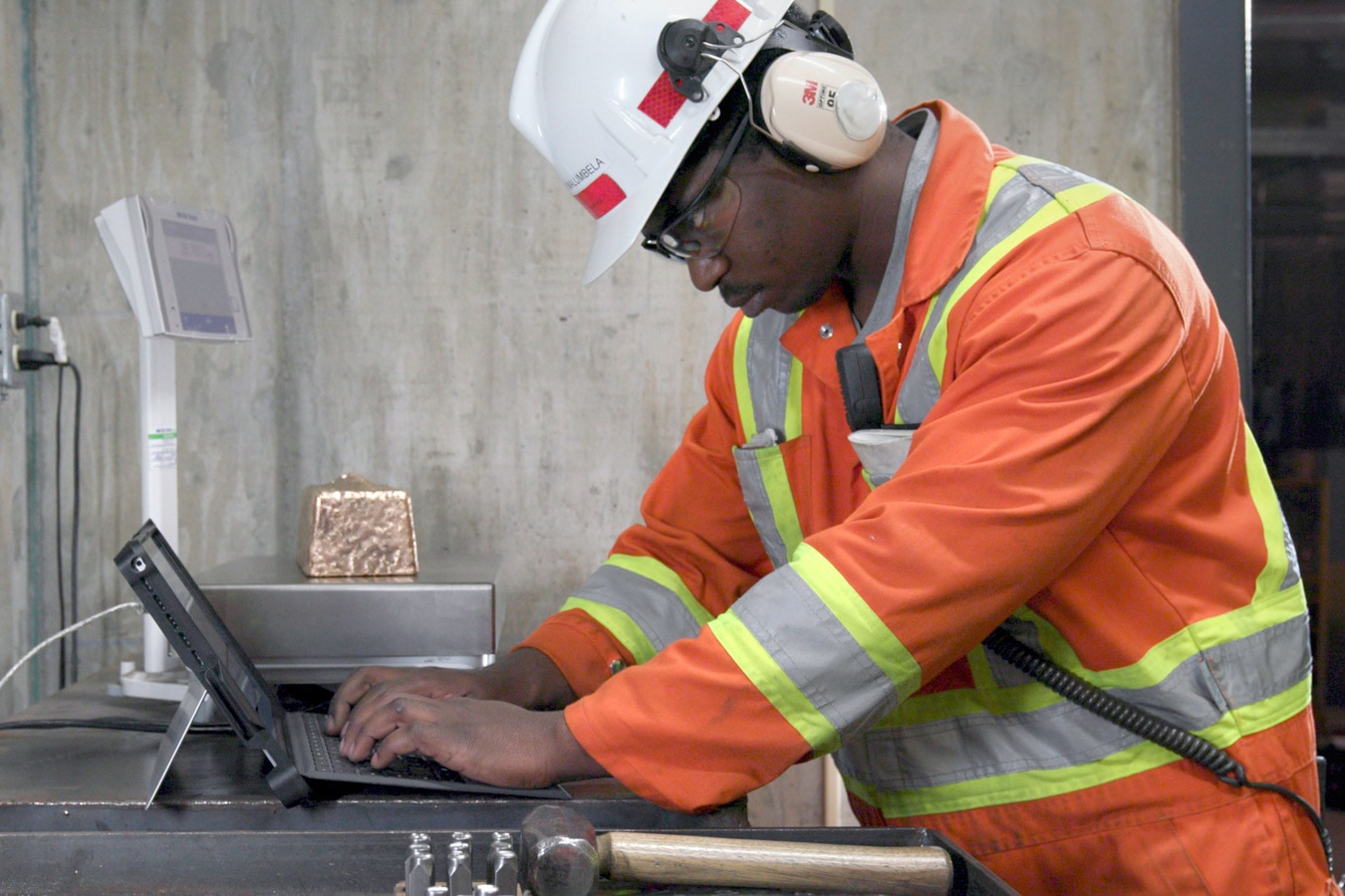 A mining engineer works with Surface Pro on the job site