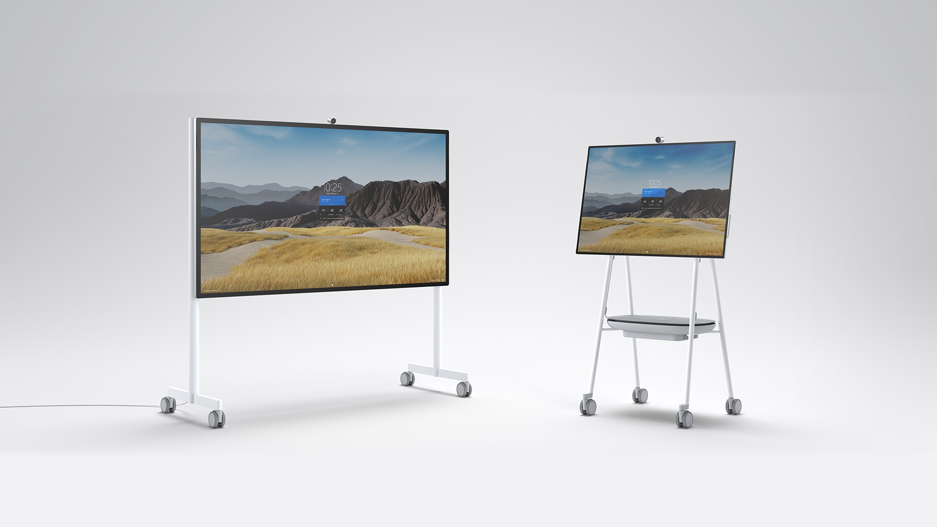 A Surface HUB 2S 85'' and 50'' on the Mobile Stand.