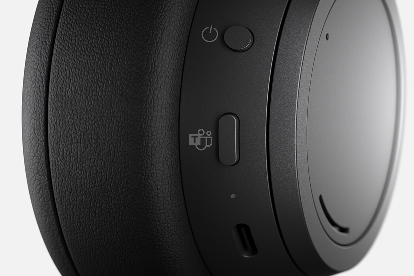 Close-up view of the Teams Button on the ear cup on Surface Headphones 2+