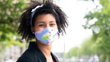 Woman wearing protective respirator mask