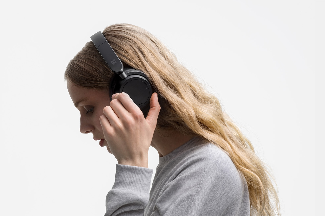 A person is shown wearing Surface Headphones 2