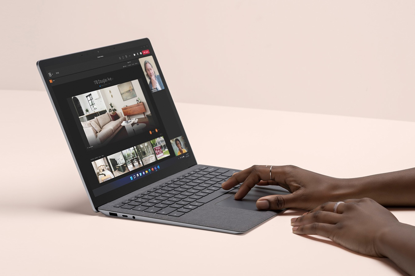 Side profile view of a Platinum Laptop 4 device, with a Microsoft Teams video call on the screen