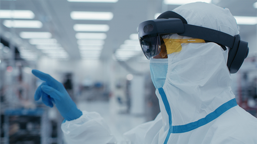 A person wearing PPE and a Holo Lens 2.