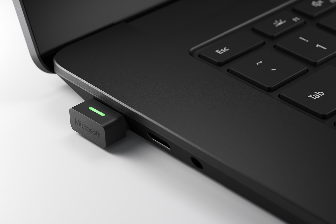 A close-up view of the USB Link connected to a Surface Pro 7+ device