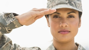 A member of the armed forces saluting in uniform.