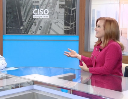 Theresa Payton and Bret Arsenault seated at a counter in a professional studio setting with CISO Spotlight Series and CISO city image in background.