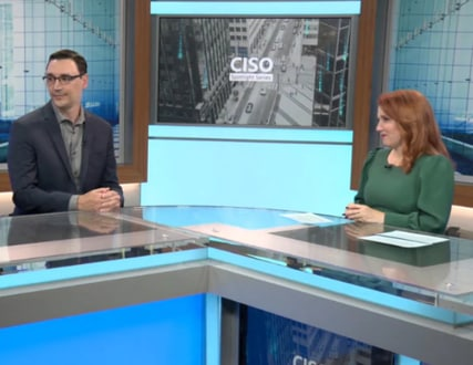 Theresa Payton, Diana Kelley and Greg Petersen seated at a counter in a professional studio setting with CISO Spotlight Series and CISO city image in background.