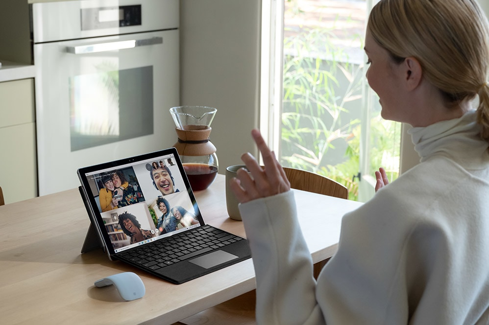 A person using Surface Pro 7+ as a tablet with Surface Pen.