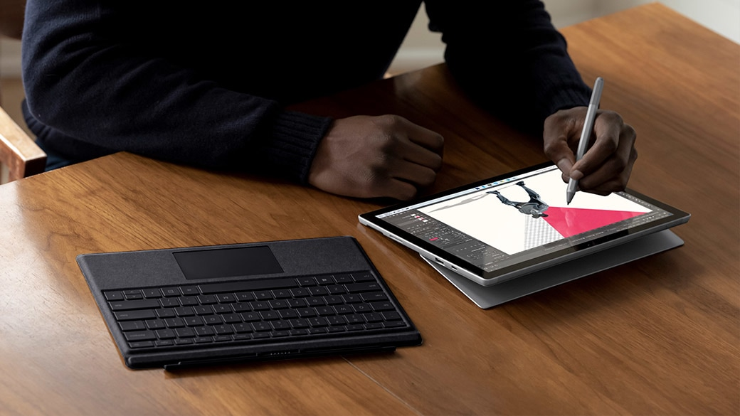 Surface Pro 7+ being used in tablet mode with Surface Pen.