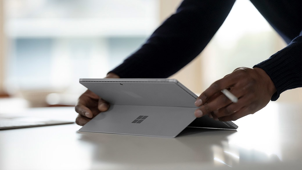 Surface Pro 7+ shown from behind in kickstand mode.