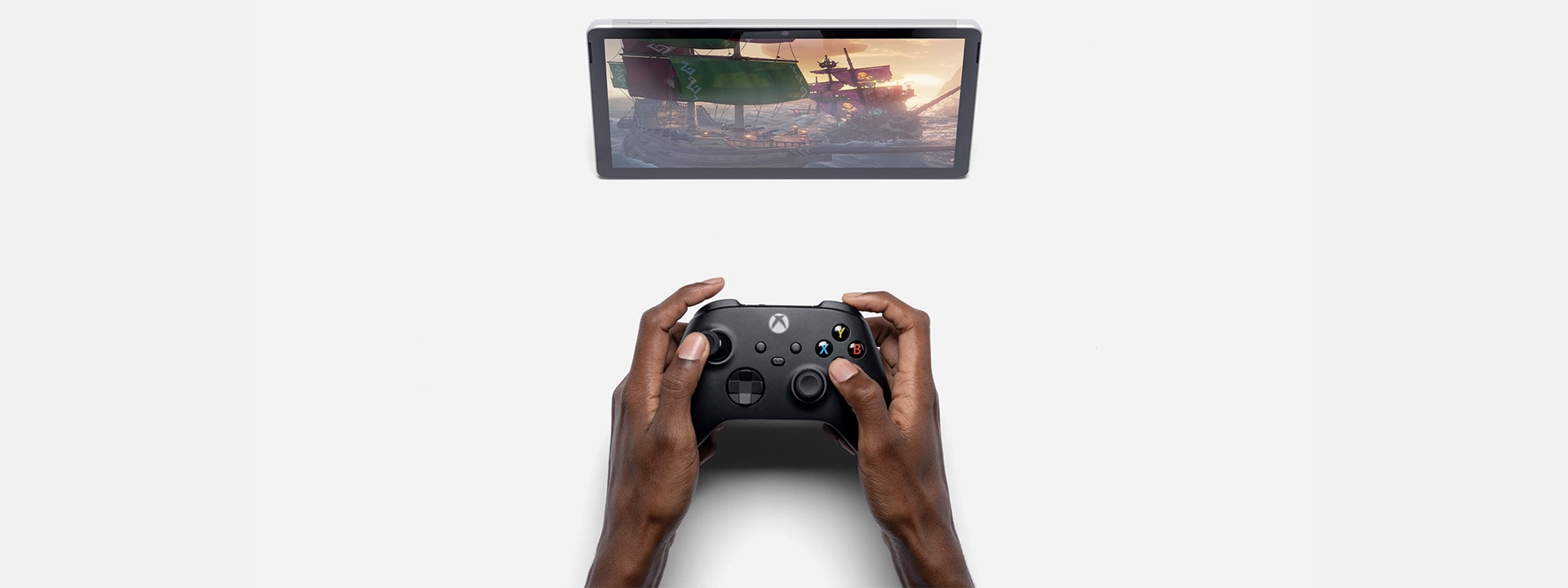 Surface Go 3 shown in kickstand mode with Xbox controller and Xbox app.