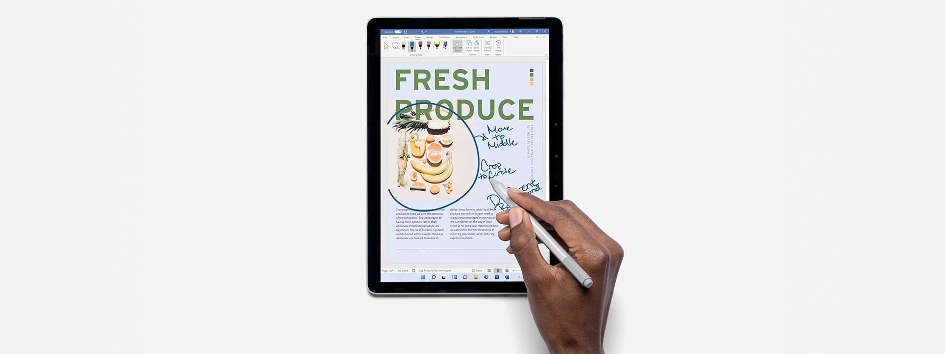 Person using Surface Pen and Surface Go 3 to work in Microsoft Word.