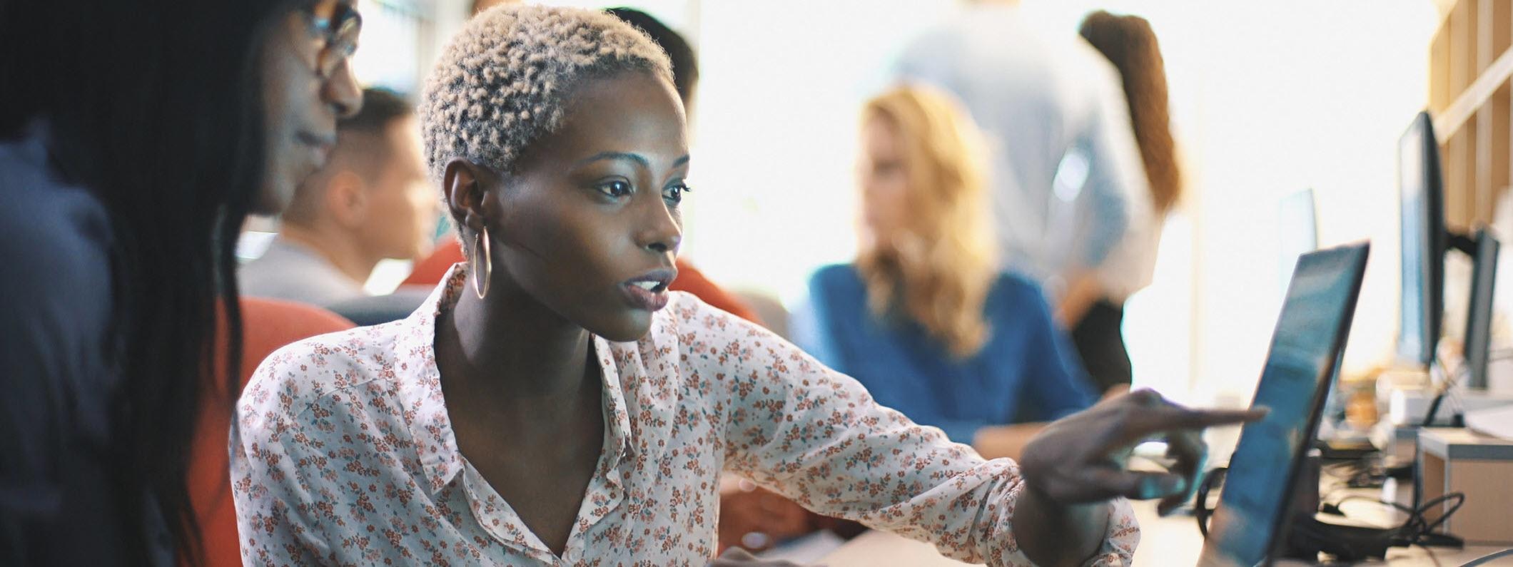 Women studies her computer screen.