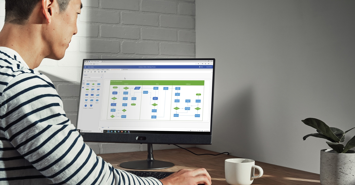 Photograph of a person looking at Visio templates on a desktop monitor