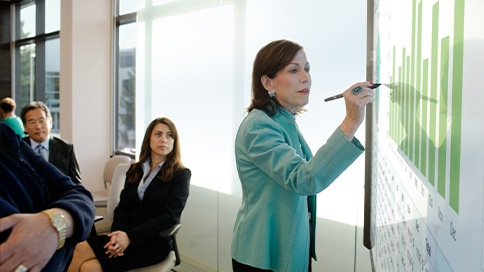 Woman explaining information in a meeting