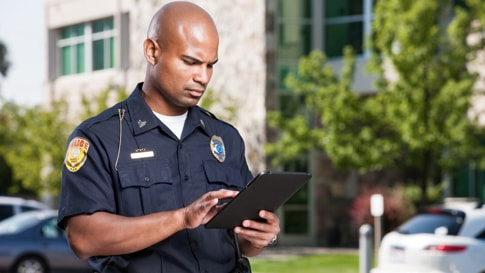 police officer using tablet in outdoor setting