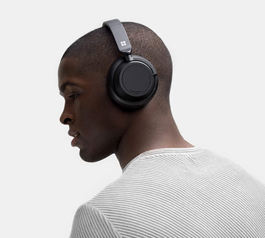 Person wearing Surface headphones