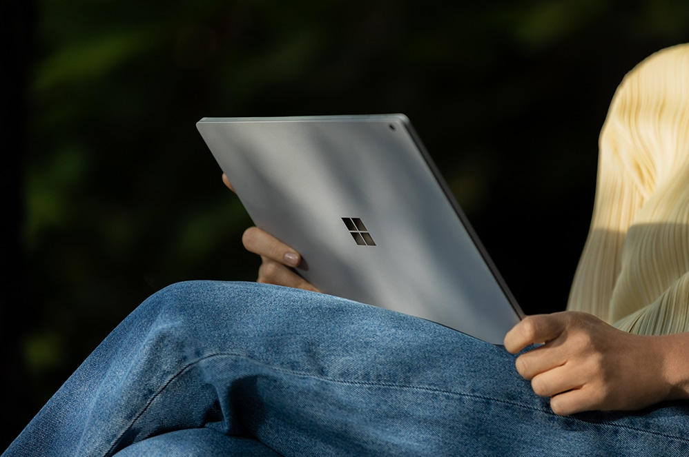 Person holding Surface Book 3 for Business on lap