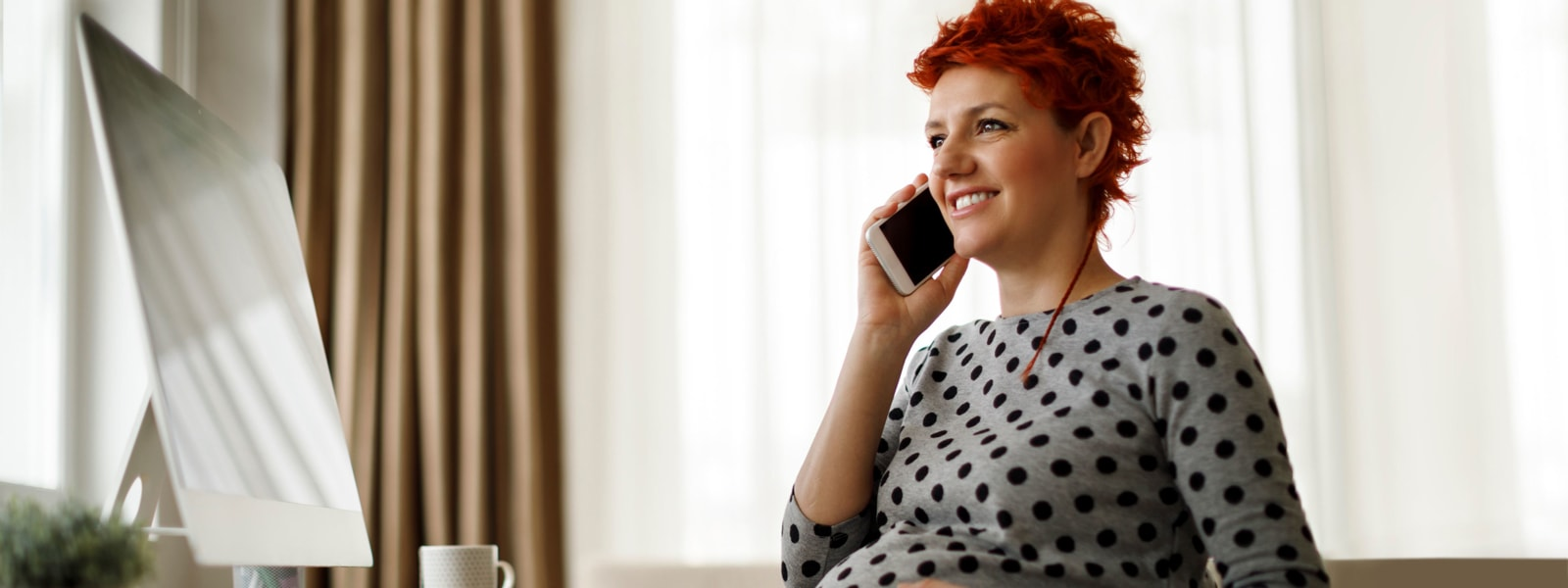 A pregnant woman talking on her smartphone