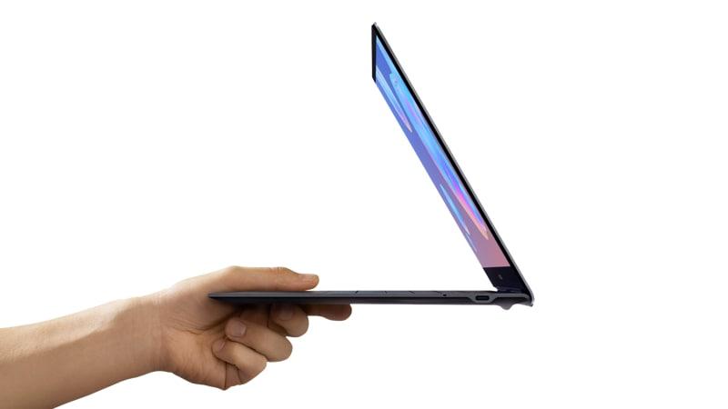 hand easily holding the Samsung Book S - Verizon Laptop