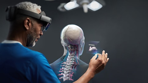 A doctor using a Hololens glass and mixed reality technology to work