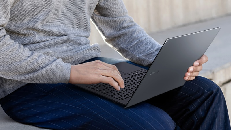 man using a Samsung Book S - Verizon Laptop